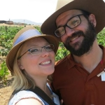 Alysha Stehly and husband in front of wine grapes